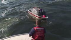 Rescue boat heaving line out Stock Footage