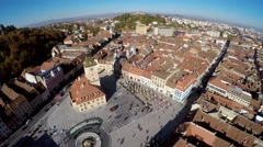 AERIAL: Panoramic aerial view of Council Square of Brasov, drone shot. Arkistovideo