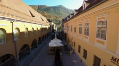 Flying through buildings on a alley in the downtown of Brasov. Stock Footage