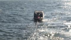 Small boat being towed Stock Footage