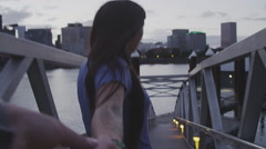 First person view of holding hands with a girl walkibg toward a boat dock Stock Footage
