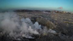 AERIAL: smoke from burning peat at dawn Stock Footage