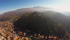 AERIAL: View of Rasnov Fortress, in Brasov county, Transylvania, Romania Stock Footage