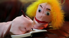 Puppet writing book journal write pen in hand Stock Footage