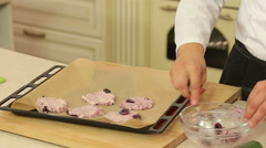 Baking cottage cheese and cherry pancakes - stock footage