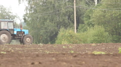 Tractor plowing a field, autumn work Stock Footage
