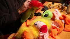 Working on puppet workshop work shop puppets Stock Footage