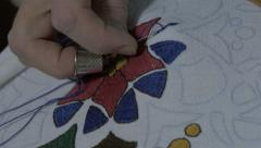Embroidery by pattern. Embroidering with needle and thread, extreme close up. Stock Footage