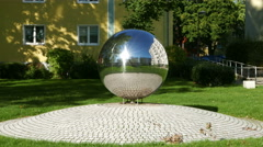 4K UHD Shining Fung-Shui decorative Metal Ball place in courtyard garden park Stock Footage