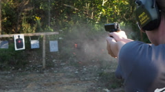 Woman Firing Hand Gun outdoor target practice Stock Footage