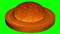 4k – One big hamburger bun on wooden board  Stock Footage