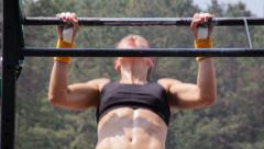 Female Athletes Performing Pullups in CrossFit Competition Training Slow Motion Stock Footage