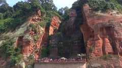 Shot from the boat,whole body of the Giant Stone Buddha at Leshan Mountain Stock Footage