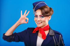 Stewardess with face art shows OK. - stock photo