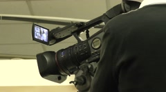 Cameramal shooting live event Stock Footage