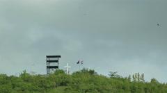 National flag of Nicaragua on mountain top Stock Footage