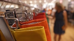 Woman Looking at Clothes in Clothing Store. Closeup Stock Footage