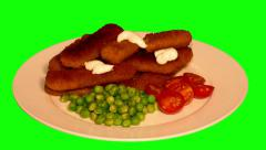 4k – Fried fish sticks with fresh vegetables on plate - stock footage