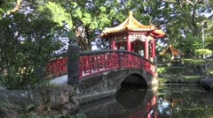 Chinese pavilion with bridge and pond in one park of Taipei City, Taiwan 4K-Dan Stock Footage
