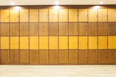 Modern wood Interior of a locker with lighting on top Stock Photos