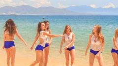 Closeup cheerleaders jump gambol wave hands in shallow water Stock Footage