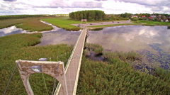 The aerial shot of the end of the Tamula lake promenade Stock Footage