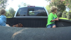 Boys Riding In Truck Bed with Dog Stock Footage
