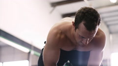 A fit young man chalking up at the gym - stock footage