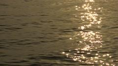 Sunlight reflecting on the ocean calm water 4k, sunset of Tamshui, Taiwan-Dan Stock Footage
