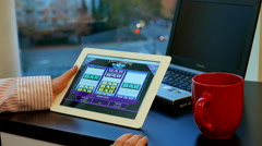 Close up woman playing slot machine game on tablet pc Stock Footage