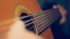 Video macroshot of the game on an acoustic guitar Stock Footage