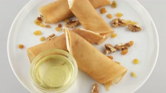 Pancakes stuffed with cottage cheese - stock footage