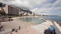 Monaco - Montecarlo. Pan shot of Larvotto beach. Parkour. - stock footage