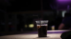 Man on bar drink coke from plastic glass Stock Footage