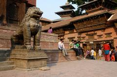 People resting at Durbar Square in Kathmandu, Nepal,popular tourist attraction Stock Photos