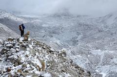 Mountaineer standing on hillside waste near Khumbu Icefall ,Nepal Stock Photos