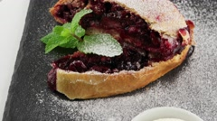 Cherry pie (strudel) with ice cream - stock footage