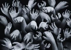 Close-up of large group of hands Stock Photos