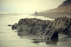 Rocks on beach, San Francisco, California, USA - stock photo