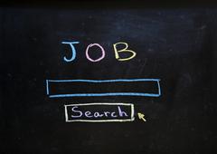 Job search written in chalk on a blackboard Stock Photos