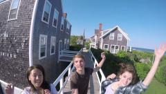 Multiethnic Teens Jump And Run With Gopro Stick For Cool Vacation Footage Stock Footage