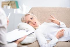 Woman speaking with psychologist - stock photo