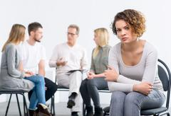Psychologist working with group of people - stock photo
