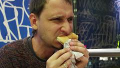 Man eating hamburger and fries portrait Stock Footage