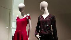 Mannequins without faces in women's clothes are at shop window the store Stock Footage