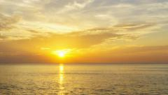 Timelapse of clouds crossing the amazing sky over the sea or ocean at sunset. - stock footage