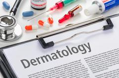 Dermatology written on a clipboard - stock photo