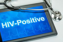 Tablet with the diagnosis HIV-Positive on the display - stock photo