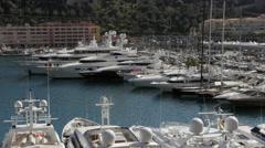 Monaco - Montecarlo. Big yachts in the harbor (Port Hércule) - stock footage