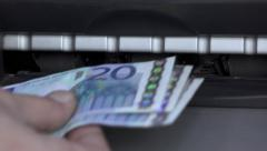 Atm machine cash withdrawal 20 euro bills,cash limit,capital controls - stock footage